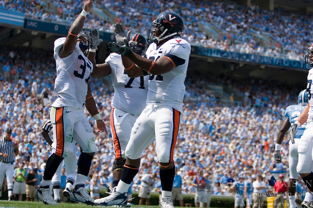 Virginia running back Cedric Peerman (37) celebrates in the end zone after scoring a rushing TD against UNC. The North Carolina Tar Heels football team faced the Virginia Cavaliers at Kenan Memorial Stadium in Chapel Hill, NC on September 15, 2007.  UVA defeated UNC 22-20.