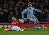 Football - 2019 /2020 FA Cup - Third Round: Arsenal vs. Leeds United.<br /> <br /> GranitXhaka (Arsenal FC) grabs hold of Jordan Stevens (Leeds United) after he slips on the turf at the Emirates Stadium<br /> <br /> COLORSPORT/DANIEL BEARHAM