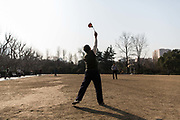 A man bounces a diabolo at Fuxing Park in Shanghai, China, on Tuesday, Feb. 6, 2016.