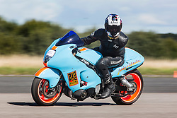 © Licensed to London News Pictures. 19/09/2015. York, UK. Picture shows a one armed rider taking part in motorbike speed record attempts at the Starightliners speed weekend has taken place at Elvington Airfield near York today were a motorised shed, Jet car & motorbikes attempt new British speed records. Photo credit: Andrew McCaren/LNP