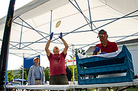 Tom Francoeur watches as Rick Nelson tosses fried dough in preparation of a busy day during the 98th annual Gilford Old Home Day festivities on Saturday morning.  (Karen Bobotas/for the Laconia Daily Sun)