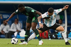 June 26, 2018 - Saint Petersburg, Russia - Oghenekaro Etebo (L) of Nigeria national team and Ever Banega of Argentina national team vie for the ball during the 2018 FIFA World Cup Russia group D match between Nigeria and Argentina on June 26, 2018 at Saint Petersburg Stadium in Saint Petersburg, Russia. (Credit Image: © Mike Kireev/NurPhoto via ZUMA Press)
