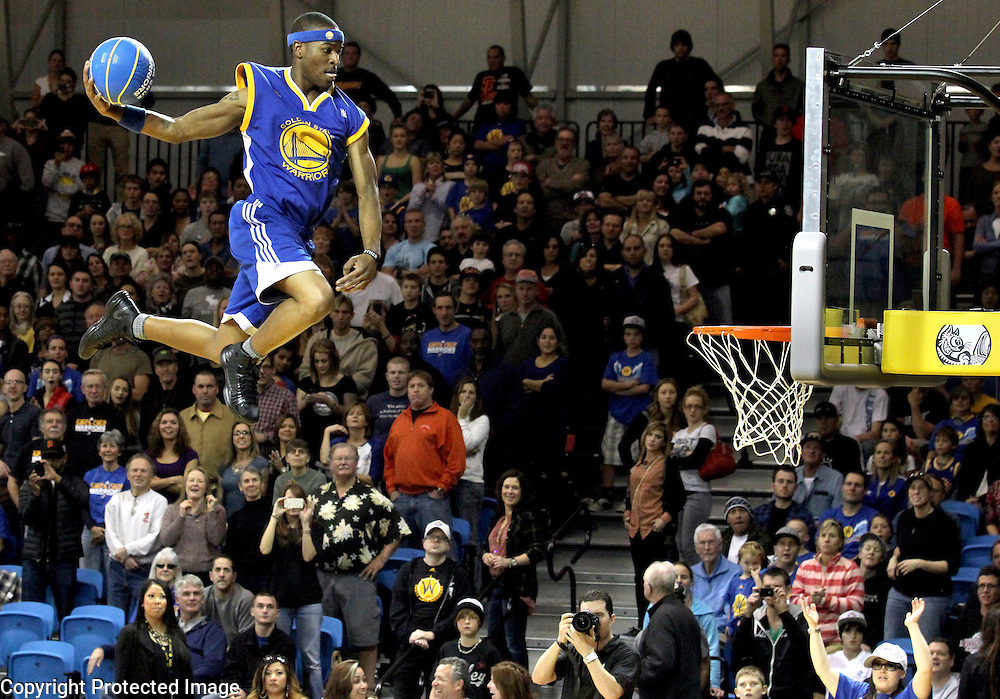 Zach Westbrook soars above the crowd at Kaiser Permanente Arena in Santa Cruz, California as he performs with the 'Flying Dubs' during halftime of the Santa Cruz Warriors' victory over the Sioux City Skyforce.<br /> Photo by Shmuel Thaler <br /> shmuel_thaler@yahoo.com www.shmuelthaler.com