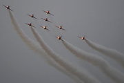 The Red Arrows display team in the rain - The Duxford Battle of Britain Air Show is a finale to the centenary of the Royal Air Force (RAF) with a celebration of 100 years of RAF history and a vision of its innovative future capability.