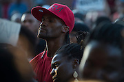 Jarvas Wright looks on during a protest at Craig Ranch North in response to an incident with teens and police officers at a community pool in McKinney, Texas on June 8, 2015.  (Cooper Neill for The New York Times)