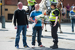 An EDL (English Defence League) organised event to lay flowers at Barkers Pool War Memorial Sheffield,  in memory of Drummer Lee Rigby, resulted in a two hour stand off when Sheffield Unite Against Fascism and One Sheffield Many Cultures supporters occupied Barkers Pool and surrounded the War Memorial leaving police to keep the opposing factions apart. <br /> Two lone EDL supporters have one final try at talking their way through to Lay their tributes<br /> 1 June 2013