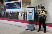 36 hours after the London Bridge and Borough Market terrorist attack, the capital returns to normality and Londoners return to their first day to work and a very visible police presence is evident at London Bridge rail station, on Monday 5th June 2017, in the south London borough of Southwark, England. Seven people were killed and many others left with life-changing injuries - but the British spirit of defiance and to carry on with every day life, endures.