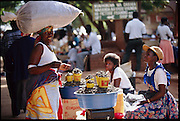 "Mopane worm merchants in the central market of Thohoyandou serve as the intermediaries between the worm wholesalers and individual customers. ""Mopane"" refers to the mopane tree, which the caterpillar eats. Dried mopane worms have three times the protein content of beef and can be stored for many months. Eaten dry the worms are hard, crispy, and woody tasting. Thohoyandou, South Africa. (Page 132,133)"