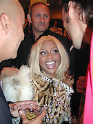 Lil Kim. Mac launch of Philanthropic lipstick. Mr. Chow's.New York. 10/2/00<br />