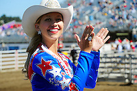 Tracy Hinson, 2012 Miss California Rodeo Salinas, leads an audience cheer before the freestyle bullfights, which opened July 19 for a four-day run.
