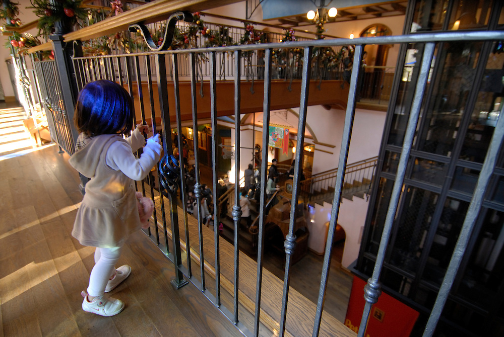 A little girl exploring the museum. The Ghibli Museum in Mitaka, western Tokyo opened in 2001. It was designed by animator Miyazaki Hayao and receives around 650,500 visitors each year.