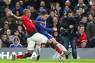 Manchester United Midfielder Ashley Young tackles Chelsea Midfielder Eden Hazard during the The FA Cup 5th round match between Chelsea and Manchester United at Stamford Bridge, London, England on 18 February 2019.