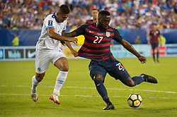 July 19, 2017 - Philadelphia, Pennsylvania, U.S - United States of America forward JOZY ALTIDORE (27) takes a shot on goal while defended by El Salvador defender HENRY ROMERO (4) during CONCACAF Gold Cup 2017 quarterfinal action at Lincoln Financial Field in Philadelphia, PA.  USA  defeats El Salvador 2 to 0. (Credit Image: © Mark Smith via ZUMA Wire)