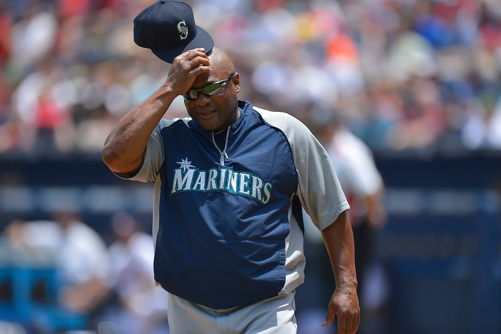 Jun 4, 2014; Atlanta, GA, USA; Seattle Mariners manager Lloyd McClendon returns to the dugout after arguing a call against the Atlanta Braves during the fifth inning at Turner Field. The Mariners won 2-0. Mandatory Credit: Kevin Liles-USA TODAY Sports