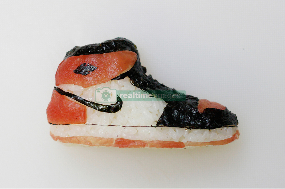 """May 3, 2017 - inconnu - There's something very fishy about this parade of top branded sports shoes.They may look good enough to wear but they are also good enough to EAT ! That's because they are all made from sushi.The shoes include designs from Adidas, Nike and Vans. They are the work of Japanese chef Yujia Hu who owns the Sakana sushi restaurant in Milan, Italy.Each piece of footwear has been carefully crafted from the main sushi ingredients of fish, rice and seaweed.And they were inspired by Yugia's love of the NBA US basketball league.He explained he first began by using balls of the rice dish known in sushi s as onigri , to represent some of the sport's biggest names.He explained:'"""" I've always been a big fan of NBA so I started creating onigri representing my favourite basketball players. """"Aside from that, one of my passions is also cinema and TV series, so other creations were iconic movie and television actors. """"My onigiris has evolved making sneakers, starting from the iconic Jordan inspired from my favorite basketball player Michael Jordan to the trending streetwear sneakers of the moment.""""He said he also wanted to give special thanks to his girlfriend """" especially thanks to my girlfriend which is a freelance fashion stylist Christine Lat.He said:"""" She has always influenced me on my creations regarding the fashion industry """"She inspired hiom to make a series of sushi fashion designers during the recent Milan fashion week.Describing his sushi works of art, he continued:"""" I take more or less 20 to 30 minutes to make an onigiri, depending on how detailed it is.""""My main ingredients are sushi rice, seaweed, and fish.""""I began creating #theonigiriart on my Instagram page , at first, just for fun, but then I started being very passionate about it and love what I am doing."""" # DES SUSHIS CHAUSSURES (Credit Image: © Visual via ZUMA Press)"""