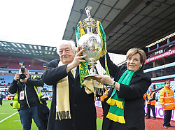 Norwich City's joint majority shareholders Delia Smith and husband Michael Wynn-Jones celebrate with the trophy after winning the Sky Bet Championship at Villa Park, Birmingham.