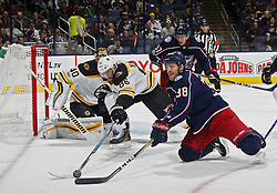 October 30, 2017 - Columbus, OH, USA - Columbus Blue Jackets center Boone Jenner (38) gains control of the puck against Boston Bruins defenseman Kevan Miller (86) during the 1st period of their NHL game at Nationwide Arena in Columbus, Ohio on Oct. 30, 2017. (Credit Image: © Kyle Robertson/TNS via ZUMA Wire)