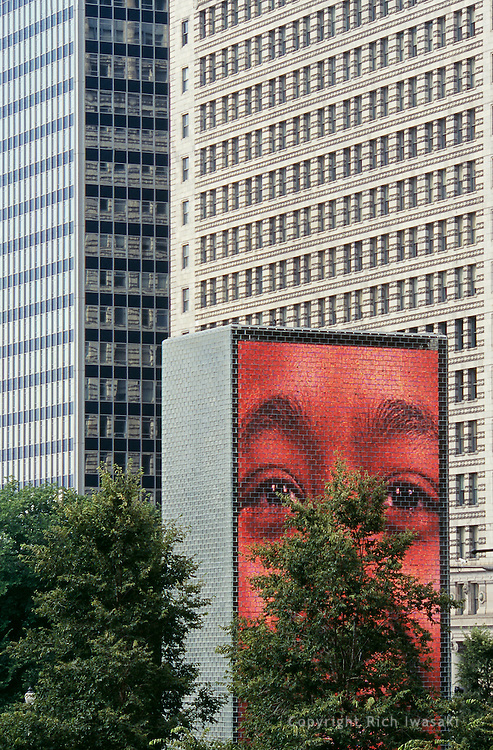 Partial view of the glass tower at The Crown Fountain in Millenium Park, Chicago, Illinois. The 50-foot glass block tower is one of two designed by Jaume Plensa, which projects video images of faces of Chicago citizens onto an LED screen.
