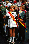 """September 1 marks the first day of school throughout Russia and Ukraine, with children ready to give flowers to their teachers. In the Ukrainian port city of Odessa, children once wore sashes that read """"first grader"""" in Russian. Since the eighteenth century, the city has always been one of Eastern Europe's most cosmopolitan  and Jewish  cities after Catherine the Great invited immigrants to make their fortunes in Odessa.  © Steve Raymer / National Geographic Creative"""