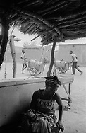 BURKINA FASO. Ouagadougou. 10/03/1985: Water carriers providing areas of the city with water from public fountains.