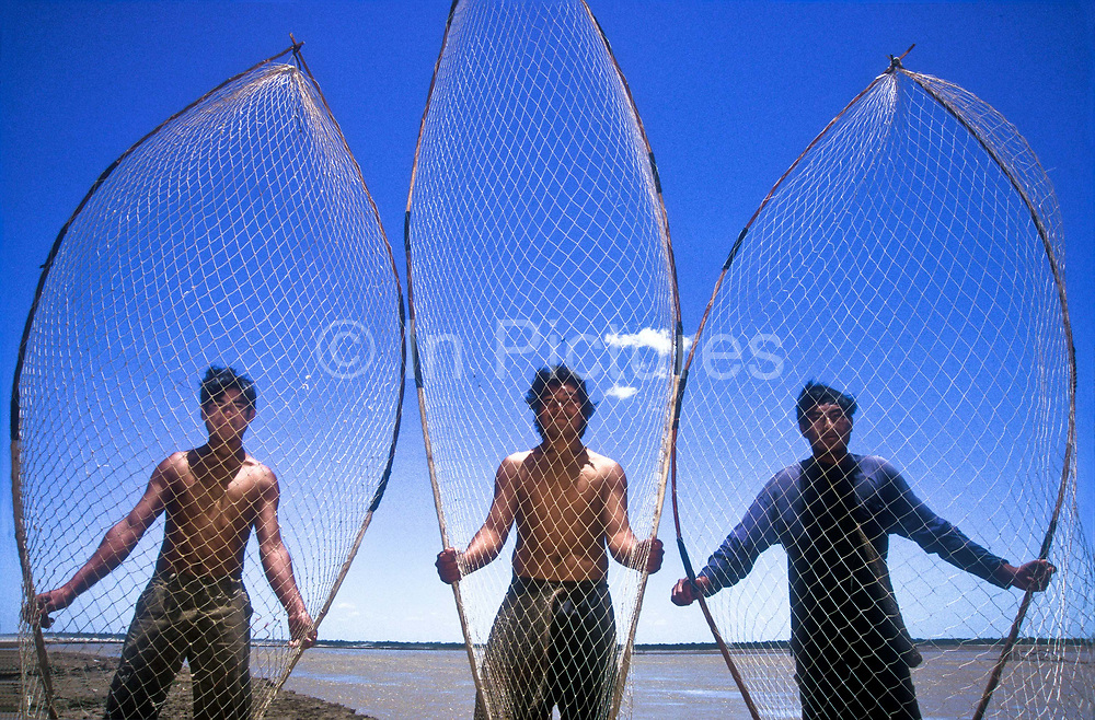 Native, Tapiete indians hold out their fishing nets along the Pilcomayo river on the border between Paraguay and Bolivia. They normally wade into the river and scoop up the fish in a sustainable way.