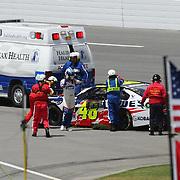 NASCAR Sprint Cup driver Jimmie Johnson (48)  exits his car after crashing during the 56th Annual NASCAR Coke Zero 400 race at Daytona International Speedway on Sunday, July 6, 2014 in Daytona Beach, Florida.  (AP Photo/Alex Menendez)