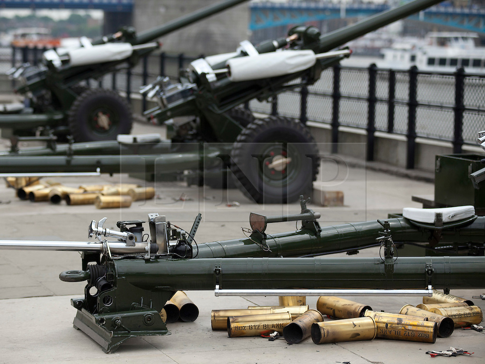 © licensed to London News Pictures. LONDON, UK  02/06/11. Spent cases litter the ground behind guns after members of the Honourable Artillery Company (HAC) fire a 62 gun salute at the Tower of London to mark the anniversary of the Queen's ascension to the throne in 1953 . Please see special instructions for usage rates. Photo credit should read Matt Cetti-Roberts/LNP