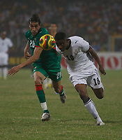Photo: Steve Bond/Richard Lane Photography.<br />Ghana v Morocco. Africa Cup of Nations. 28/01/2008. Eric Addo (R) nods the ball in front of Yousef Hadji (L)