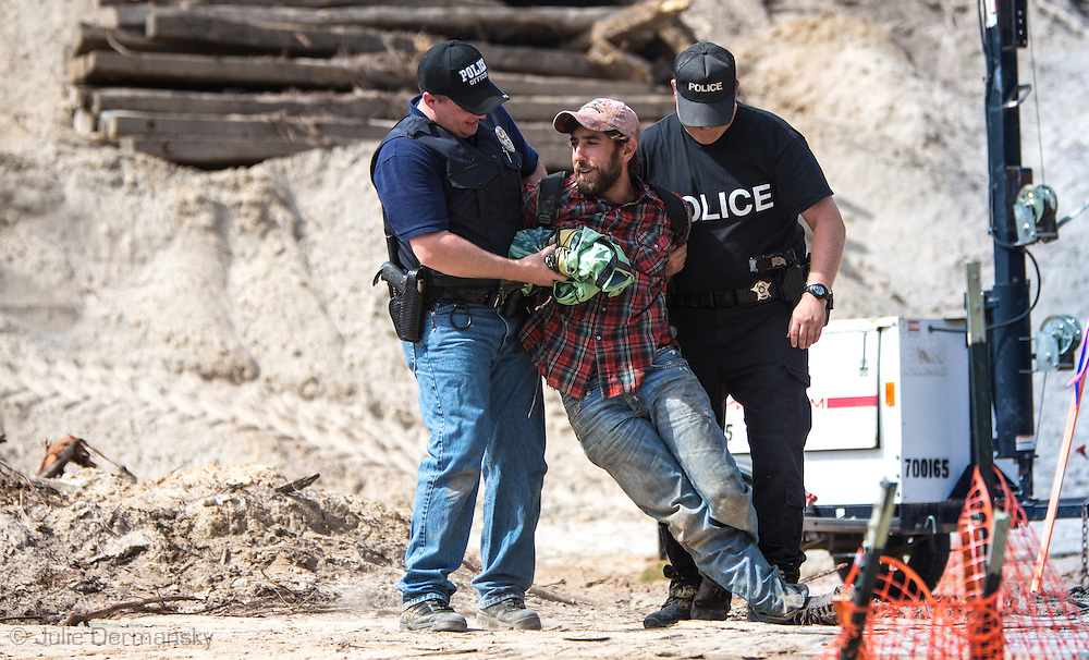 Man arrested after climbing on a work vehical on a TransCanada work area during the Tar Sands Blockade on Oct. 15th