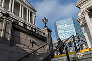 Days before the Chancellor Rishi Sunak delivers his Budget, a wide view of the Bank of England (left) and Royal Exchange (right) in the City of London, the capital's financial district, on 1st March 2021, in London, England.