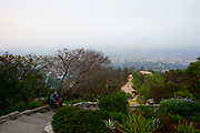 People Sitting on the Stairs at the Observatory Overlooking Los Angeles
