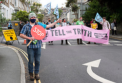© Licensed to London News Pictures; 11/06/2021; St Ives, Cornwall UK. G7 summit in Cornwall. A protest by Extinction Rebellion processes through the streets of St Ives on the first day of the G7 summit. Photo credit: Simon Chapman/LNP.