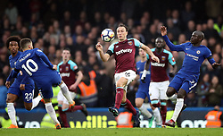 West Ham United's Mark Noble (centre), Chelsea's N'Golo Kante (right) and Eden Hazard battle for the ball during the Premier League match at Stamford Bridge, London.