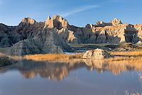 Badlands hoodoos reflected in seasonal pools, Badlands National Park South Dakota USA