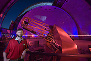 .COMPOSITE PHOTO. Lick Observatory on Mt. Hamilton. San Jose, California. Chris McCarthy, astronomer, with the 120-inch telescope. THIS IMAGE COMBINES TWO DIFFERENT EXPOSURES OF THE TELESCOPE AND DOME IN THE BACKGROUND. SEE 263 AND 268 FOR ORIGINAL IMAGES.  Exoplanets & Planet Hunters