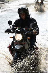 Kiwi Mike Tomas encountering a flooded piece of road on day-4 of our Himalayan Heroes adventure riding from Pokhara to Kalopani, Nepal. Friday, November 9, 2018. Photography ©2018 Michael Lichter.