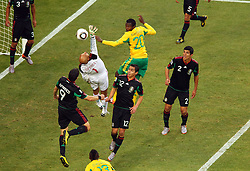 Mexico's goalkeeper Oscar Perez vs South Africa's Bongani Khumalo during the Group A first round 2010 FIFA World Cup South Africa match between South Africa and Mexico at Soccer City Stadium on June 11, 2010 in Johannesburg, South Africa.  (Photo by Vid Ponikvar / Sportida)