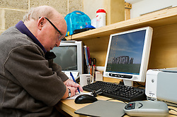 Disabled man working on the Disability Essex helpline, UK