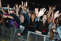 © Licensed to London News Pictures. 30/08/2015. Reading, UK. Years and Years fans watch the band performing at Reading Festival 2015, Day 3 Sunday.  Photo credit: Richard Isaac/LNP