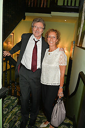 LORD & LADY HOLLICK at a Bastille Day Cocktail Party at L'Escargot, 48 Greek Street, London on 14th July 2014.