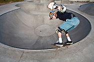 An aggressive skate boarder takes to the new drops in the freshly made park
