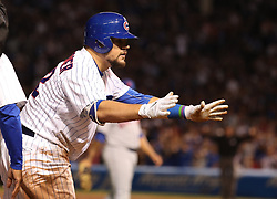 September 14, 2017 - Chicago, IL, USA - The Chicago Cubs' Kyle Schwarber gestures toward the dugout after advancing to third base on an error after his double in the third inning against the New York Mets at Wrigley Field in Chicago on Thursday, Sept. 14, 2017. (Credit Image: © Chris Sweda/TNS via ZUMA Wire)