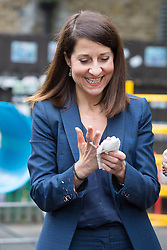 © Licensed to London News Pictures. 08/09/2015. London, UK. Labour party leadership candidate, LIZ KENDALL MP cleans her hands and jacket after painting durin gher visit to Clapham Manor Children's Centre in south west London. Photo credit : Vickie Flores/LNP
