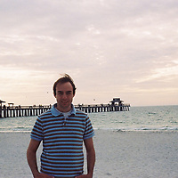 1. When was this photo taken?<br /> <br /> 2002<br /> <br /> 2. Where was this photo taken?<br /> <br /> Florida<br /> <br /> 3. Who took this photo?<br /> <br /> I did<br /> <br /> 4. What are we looking at here?<br /> <br /> My boyfriend.<br /> <br /> 5. How does this old photo make you feel?<br /> <br /> This makes me feel happy. We had just graduated from college and moved to DC where we didn't know anyone. My boyfriend almost immediately accepted a temporary position in Florida and was away for 3 months. This was taken when I went down to visit him. I remember how excited I was to see him. I still think about that excitement sometimes when I feel like I'm taking him for granted.<br /> <br /> 6. Is this what you expected to see?<br /> <br /> I had no idea.<br /> <br /> 7. What kind of memories does this photo bring back?<br /> <br /> This brings back memories of trying to figure out adulthood and feeling scared, but very grown up.<br /> <br /> 8. How do you think others will respond to this photo?<br /> <br /> To anyone else it's just some guy on a beach.