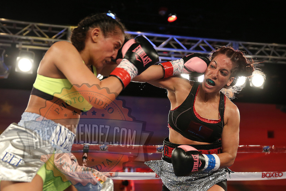 Noemi Bosques (R) throws a right hand against Nydia Feliciano during a Telemundo Boxeo boxing match at the A La Carte Pavilion on Friday,  March 13, 2015 in Tampa, Florida.  Feliciano won the bout by split decision. (AP Photo/Alex Menendez)