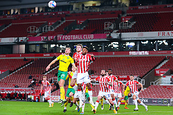 Tyrese Campbell and Harry Souttar of Stoke City duel in the air with Ben Gibson of Norwich City  - Mandatory by-line: Nick Browning/JMP - 24/11/2020 - FOOTBALL - Bet365 Stadium - Stoke-on-Trent, England - Stoke City v Norwich City - Sky Bet Championship