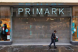 Glasgow, Scotland, UK. 21 November 2020. Views of Saturday afternoon in Glasgow city centre on first day of level 4 lockdown. Non essential shops and businesses have closed. And streets are very quiet. Pictured; Primark store is shuttered and closed  .Iain Masterton/Alamy Live News