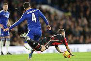 Cesc Fabregas of Chelsea pushes Dan Gosling of Bournemouth over. Barclays Premier league match, Chelsea v AFC Bournemouth at Stamford Bridge in London on Saturday 5th December 2015.<br /> pic by John Patrick Fletcher, Andrew Orchard sports photography.