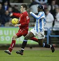 Fotball<br /> England 2004/2005<br /> Foto: SBI/Digitalsport<br /> NORWAY ONLY<br /> <br /> Coca-Cola League 1<br /> 03/01/2005.<br /> <br /> Huddersfield v Bristol City<br /> <br /> Bristol's Paul Heffernan shields the ball from Huddersfield's Efe Sodje
