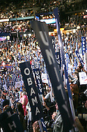 Unity signs at the second night of the Democratic Convention in Denver, Colorado. Photograph by Dennis Brack
